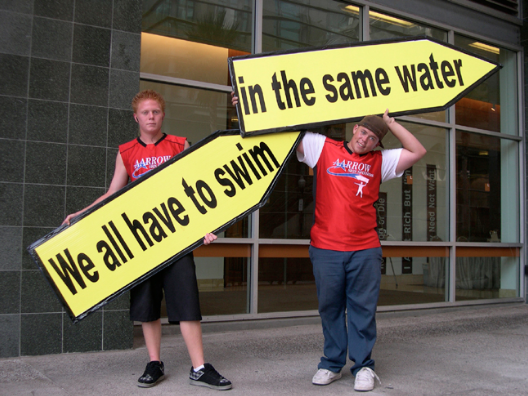 Allison Wiese, We All Have to Swim in the Same Water, 2007, arrow signs and professional stunt sign-spinners. Image courtesy of www.allisonwiese.com