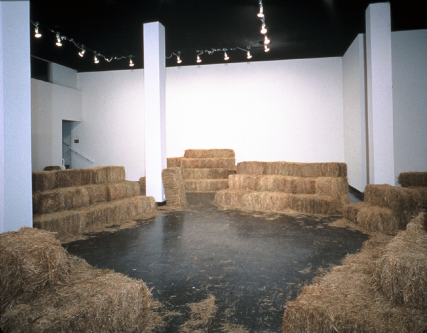 Allison Wiese, Hay Burner, 2003, dimensions variable, 100 hay bales, Borrowed hay bales arranged into an amphitheater in Lawndale Art Center's Main Gallery. Image courtesy of www.allisonwiese.com