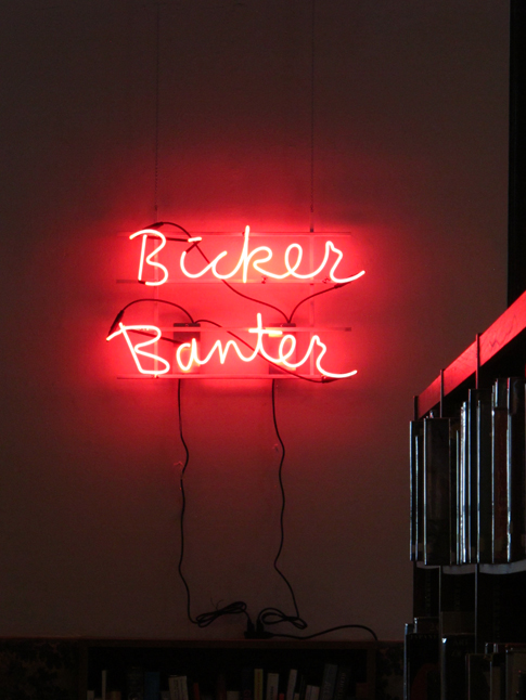 Allison Wiese, Bicker / Banter, 2014, neon signage, separate transformers/switches power two words, 20 h x 30 w x 2.5 d inches, edition: six. Image courtesy of www.allisonwiese.com
