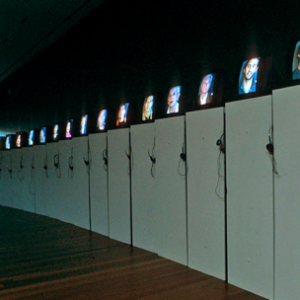 Lise Swenson, Questions and Answers, 2005, thirty monitor video installation, Installation view, de Young Museum. Image courtesy of www.liseswenson.com