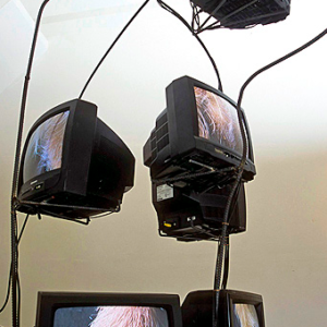 Lise Swenson, Enid, 2003, eight monitor wire frame video sculpture on two foot dais, Installation view, SFCA. Image courtesy of www.liseswenson.com
