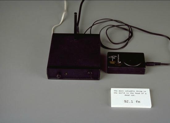 Paul Dickinson, Buddha Radio, 1999, Low-power FM transmitter, Buddhist electronic chant box, cards, wire, antenna. Image courtesy of www.goshyes.com