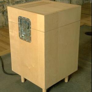 Paul Dickinson, DanTien Subwoofer, 2001, birch plywood, CD player, amplifier, speaker, hardware, felt. Image courtesy of www.goshyes.com