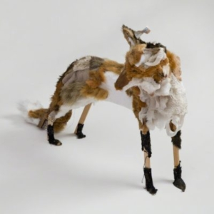 Kathryn Spence, Red Fox and Object, 2011, wood, towels, pants, socks, sweater, skirt lining, toy stuffed bear, dog, fox tiger, Styrofoam, sand, dirt, thread, pins 22 x 26 x 9 inches. Image courtesy of Wirtz Art