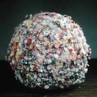 D'nell Larson, The Abominable Snowball, 1995, metal frame, artificial flowers, snow flakes. Image courtesy of www.aptglobal.org