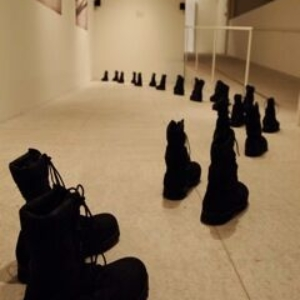 John Q, Discursive Documents: Performing the Catalogue, 2010, installation (archival inkjet, boots, sound), dimensions variable