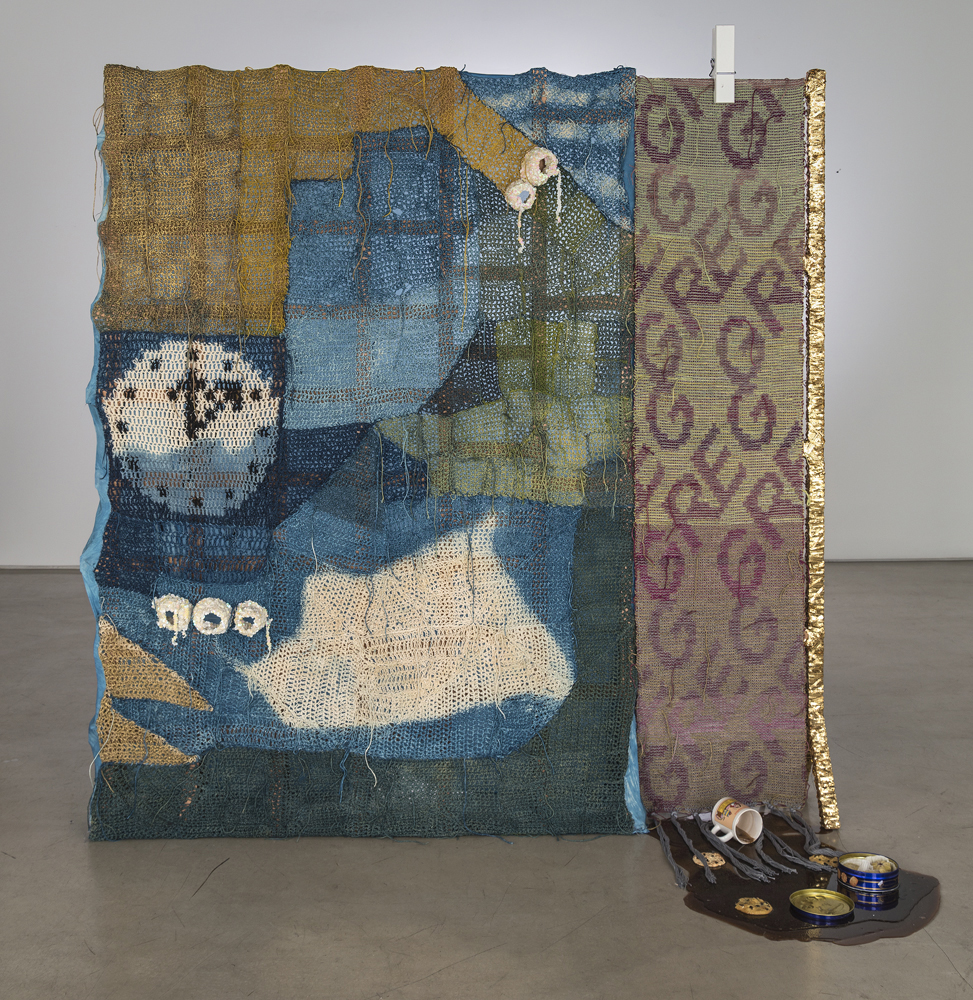 Josh Faught, Greg, 2014, Hand woven and crocheted hemp (hand dyed in colors to match the 2013/2014 color forecast, Indigo, gold spray paint, sequin trim, silk, wool, giant clothes pin, spill (resin) with Cathy mug, chocolate chip cookies (plastic), and tin of butter cookies (plastic and metal) on Cedar support, 76 x 74 x 12 inches