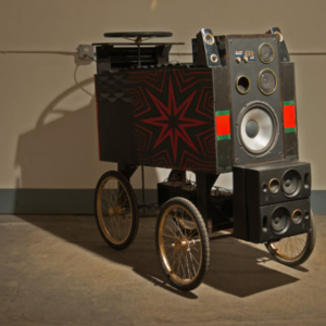 Cosmo Whyte, The Well Traveled African, 2015, reclaimed shipping palettes, 4 bicycle wheels, steering wheel, 5 speakers, 3 car batteries, 6 x 3.5 x 4 feet