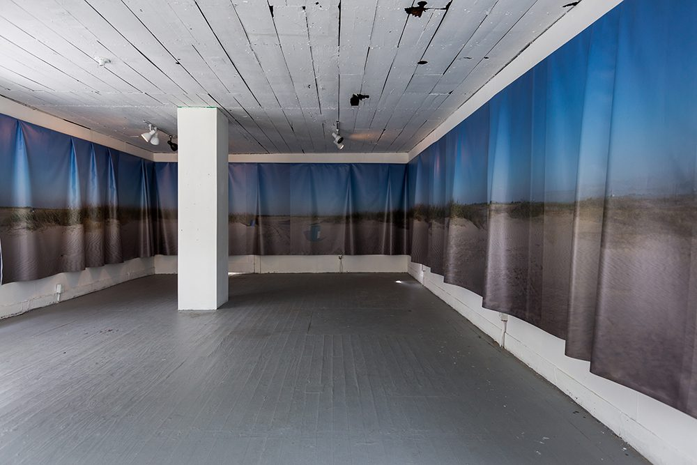 Regina Agu, Sea Change (installation view at Project Row Houses), 2016, vinyl print, 80 x 6 feet