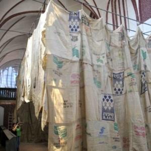 Kaneem Smith, THEBAI: A Chapel for Saint Maurice (installation view), 2012, burlap, jute, brass, acrylic, 20 x 25 x 40 feet