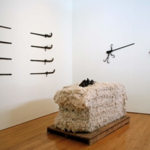 Kaneem Smith, Reap and Sow (installation view), 2013, (reclaimed) 800 lb. cotton bale, iron hanging scales, dimensions variable