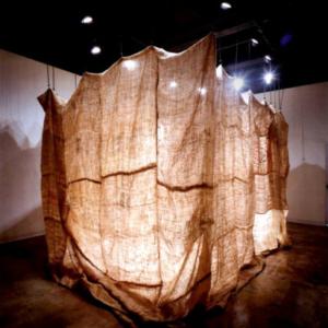 Kaneem Smith, Contentment in Misinterpretation, 2008, burlap, jute cord (installation), 10 x 12 square feet