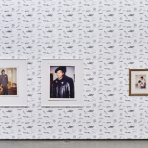 """Sadie Barnette, Exhibition Detail:Left: Untitled (Dad, 1966 and 1968), Two c-prints, 46x40 in. each, 2016. Right: Untitled (Dad in postal uniform with family…) C-print in gold frame, 24x18 in., 2017.Wall paper: """"Special Agents,"""" custom vinyl wall paper, dimensions vary, 2017."""