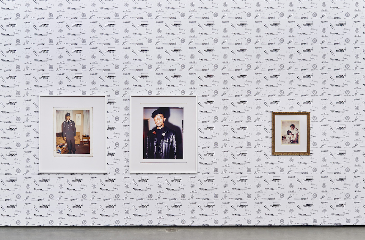 "Sadie Barnette, Exhibition Detail: Left: Untitled (Dad, 1966 and 1968), Two c-prints, 46x40 in. each, 2016. Right: Untitled (Dad in postal uniform with family…) C-print in gold frame, 24x18 in., 2017.Wall paper: ""Special Agents,"" custom vinyl wall paper, dimensions vary, 2017."